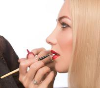 Make-up artist apply bloody lipstick Stock Photos