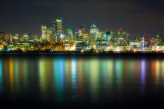 Panorama of the city at night reflected in water, seattle, usa Stock Photos
