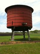 Red Vintage Railroad Train Water Tower - stock photo