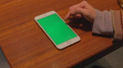Iphone 6 plus phone green screen - on table finger scrolling up Stock Footage