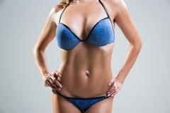 Beautiful female stomach and chest. Stock Photos