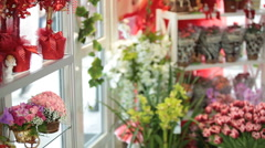 Flower shop interior with floral arrangements and bouquets for Valentine's Day - stock footage