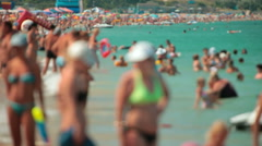 Crowd of people  at the summer beach vacation sunbathing swimming in the sea Stock Footage