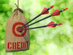Stock Illustration of Credit - Arrows Hit in Red Target.