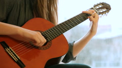 Teenager Girl Playing Guitar Stock Footage