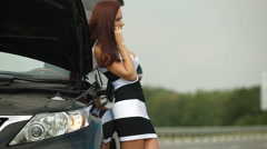 Woman having car troubles on the road calling for emergency repair service Stock Footage