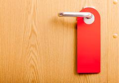 Empty door do not disturb sign Stock Photos
