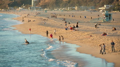 Santa Monica Beach Sand People Wading Water Waves Blue Sea Sandy Shore Stock Footage