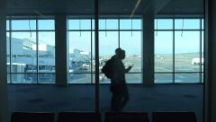 People in Airport Breezeway Stock Footage