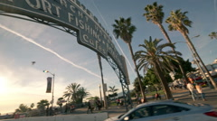 Car driving into Santa Monica Pier entrance sign in Los Angeles, California Stock Footage