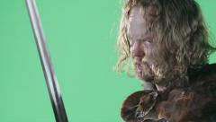 A Medieval Warrior Prepares For A Battle In Front Of A Green Screen. Stock Footage