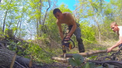 Woodcutters sawed big log Stock Footage