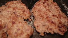Minced steak just fried in hot pan - closeup Stock Footage