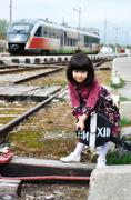 Little girl on a train station - stock photo