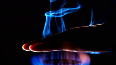 Hand Burning Stock Footage