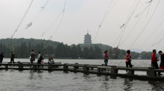 Lei Feng tower and stone bridge on the west lake - stock footage