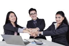 Entrepreneurs team showing unity with their hands Stock Photos