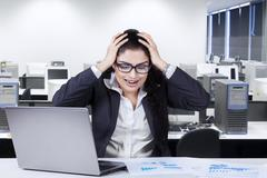 Frustrated worker in the office Stock Photos