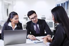 Male manager pointing a document in meeting Stock Photos