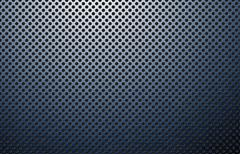 perforated polished metal surface - stock photo