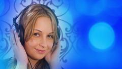 Young woman listening to music and blue defocused light Stock Footage