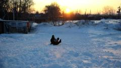 Child is sledding. Stock Footage