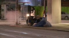 Desperate homeless hungry people on the streets of Toronto in winter Stock Footage