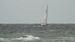 Sailing boat on rough sea Stock Footage