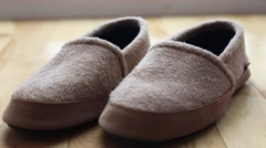 Stock Video Footage of a man wears a pair of slippers dolly shot