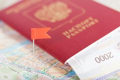 passport with money lies on the tourist map - stock photo