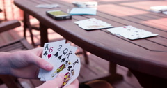 Playing Bid Euchre card game 4k Stock Footage