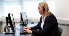 Call center agent working at desk - stock footage