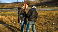 Instructor unfasten from leaping girl brake rope - stock footage