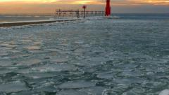 Icy Cold Harbor With Ice Glazed Pier and Lighthouse Stock Footage