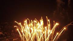 AERIAL SLOW MOTION: Gold fireworks for New Year's - stock footage