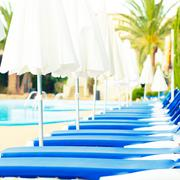 sunbeds around the pool - stock photo