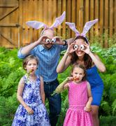 Funny family easter portrait. Part of a series. Stock Photos