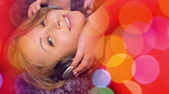 Pretty young woman in headphones listening music background Stock Footage