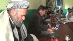 Afghan men eating together at restaurant in Kabul Afghanistan Stock Footage