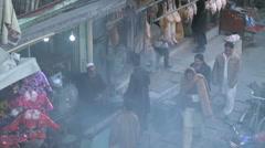 Afghans walking around food market in Kabul Afghanistan Stock Footage