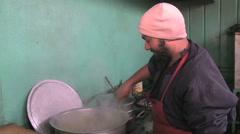 Cook preparing food at food market in Kabul Afghanistan Stock Footage
