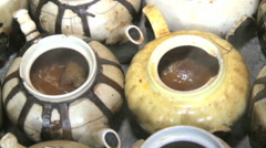 Bowls of hot food simmering in kitchen of food market Kabul Afghanistan Stock Footage