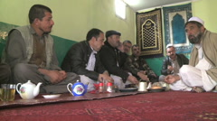Group of 7 Afghan men eating together at a restaurant in Kabul Afghanistan Stock Footage