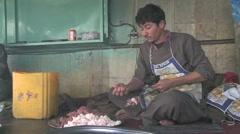 Afghan man prepares food at a Kabul Afghanistan food market Stock Footage