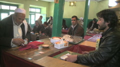 Man placing order for food Kabul food market Stock Footage
