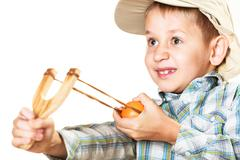 Kid holding slingshot in hands Stock Photos