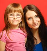 portrait mother and cute daughter - stock photo