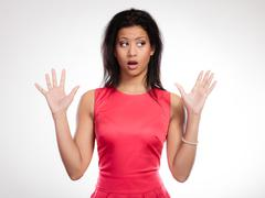 Gossip or stress. surprised shocked scared woman. emotional facial expression Stock Photos