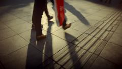 People walking crowd footsteps long shadows silhouettes 3 warm fx Stock Footage