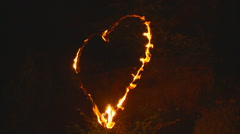 Love heart in flames 30 secs Stock Footage